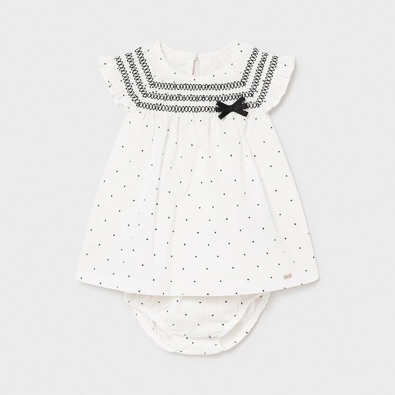 Vestido lino lunares recién nacida niña. Manga sisa para recién nacida,Pequeña abertura en la espalda con cierre de botón.