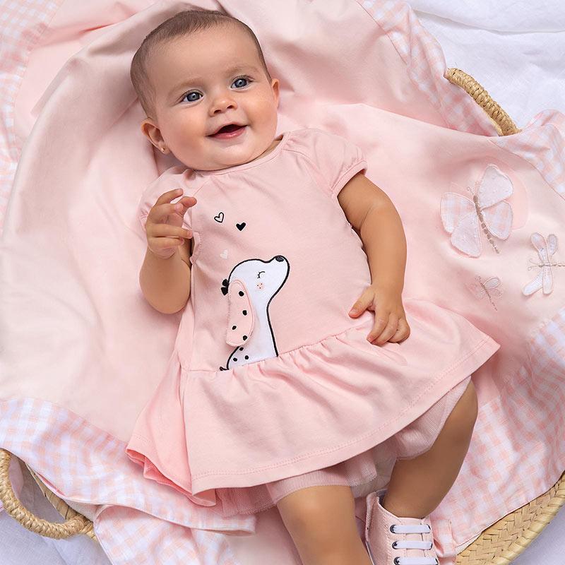 Vestido punto perrito rosa recién nacido Mayoral. Dulce, comódo y bonito es este vestido de punto. Volante en el bajo. Gráfica de perrito.
