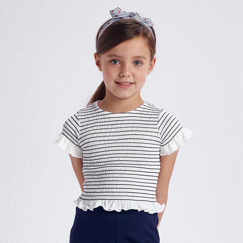Camiseta manga corta nido de abeja niña. Cuello redondo. Diseño con volante decorativo en el bajo de la prenda. Marino y blanca.