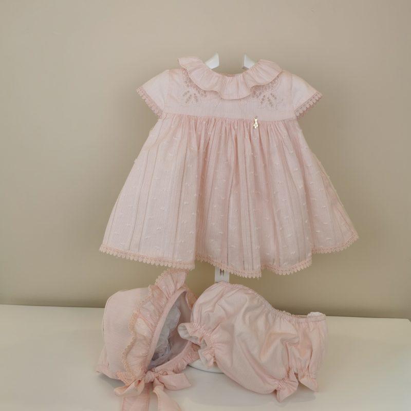 Tejido muy bonito de algodón en rosa, Corte canesú, manga corta, volante en cuello.